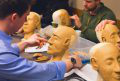 photo of students learning restorative art using clay model heads at 快三平台